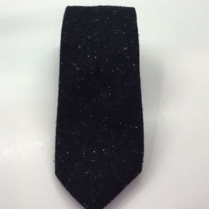 Black wool and cashmere blend tie, while flecks